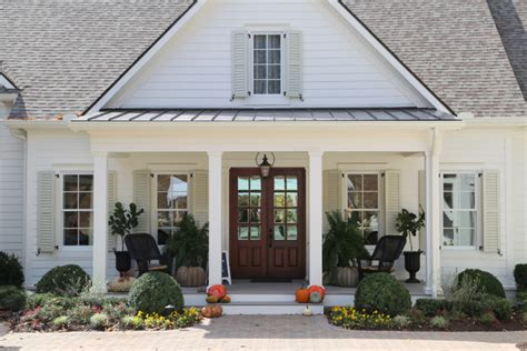 classic farmhouse painted sherwin williams dover white shutters are sw ancient marble paint