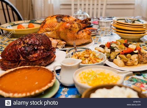 thanksgiving table with turkey thanksgiving turkey dinner on table usa stock photo
