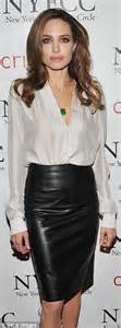 wears a leather skirt to the critics