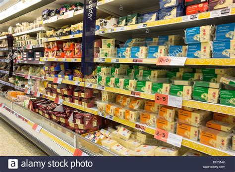 product section interior of sainsbury s supermarket cheese section uk