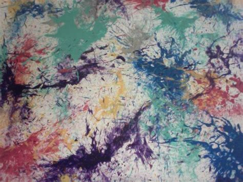acrylic paint onto a canvas then submerge into water balloon splatter paint on a canvas pour acrylic paint