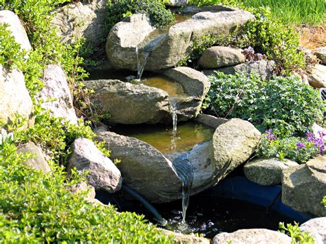 building ponds and waterfalls in backyard a backyard waterfall is easier than you think tsurumi
