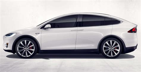 Tesla Suv Price Tag News Tesla Model X Suv Officially Sees Light Of Day Gets
