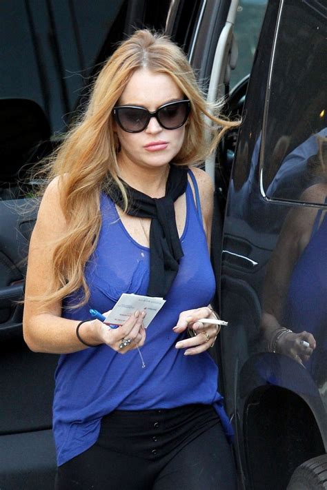 Lindsay Lohan Is Actually Wearing A Bra by Lindsay Lohan Does Some Banking Zimbio