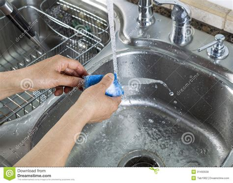 washing single small knife in kitchen sink
