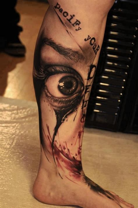 tattoo eye leg quot pacify your dead quot two tone lower leg tattoo with