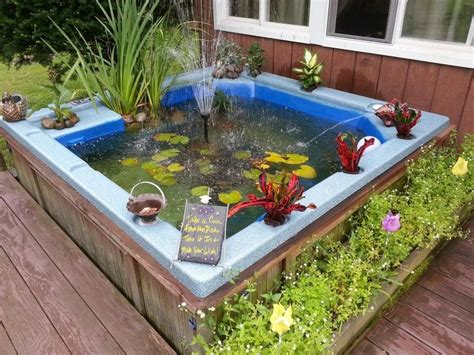 bathtub fish pond upcycled broken hot tub into a fish pond our best tips