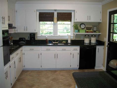brown kitchen cabinets with black appliances