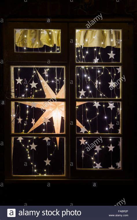christmas house window displays festive christmas house window display christmas star and lights stock photo royalty