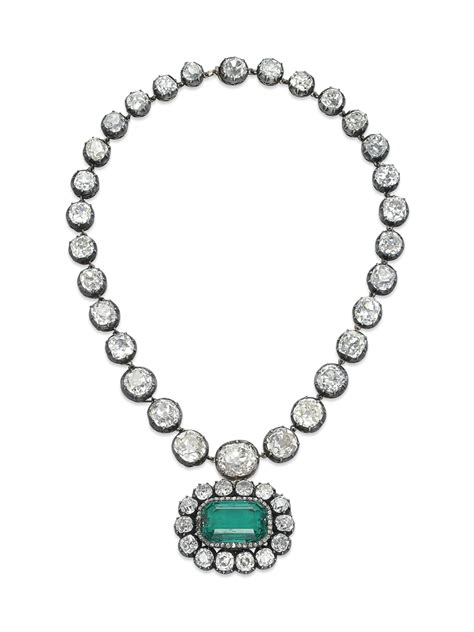 an antique emerald and necklace jewelry auction