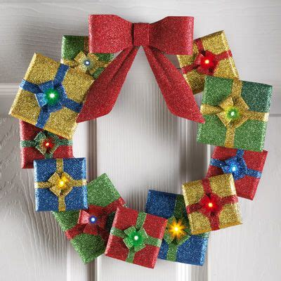 lighted door wreaths for christmas lighted holiday gifts door wreath not sure how long 2 aaa