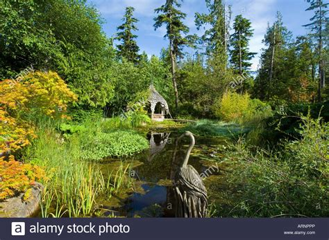 Tofino Botanical Gardens Tofino Botanical Gardens Pond With Wood Sculpture Vancouver Stock Photo Royalty Free