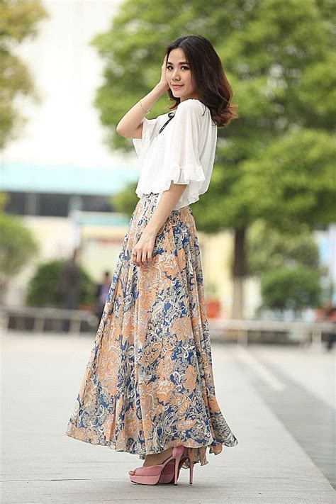 a full length printed skirt gets a touch of luxe via a full length floral print silk skirt elastic waist by