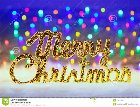 merry christmas written in gold with lights royalty free