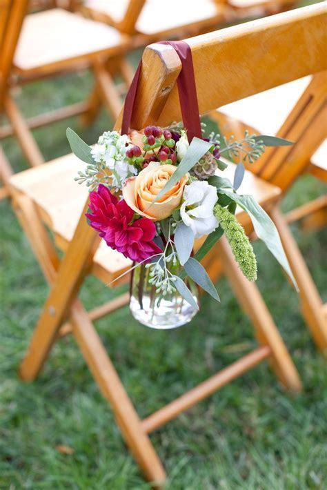 roses hanging in jar for outdoor wedding ceremony folding