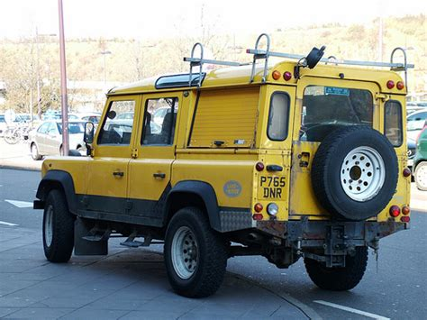yellow land rover flickr photo