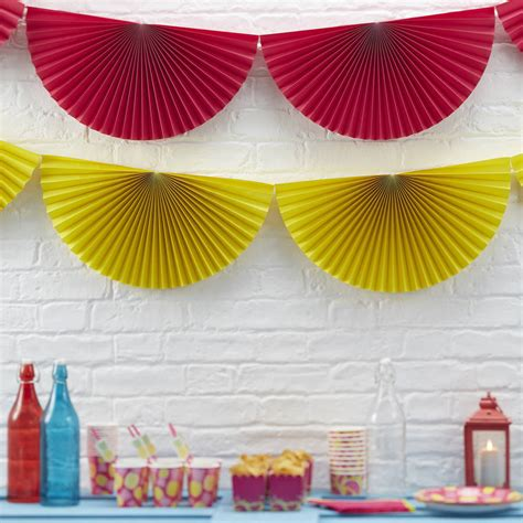 pink paper hanging fan decorations by
