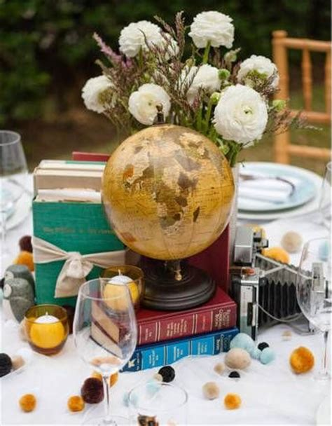 travel themed centerpiece ideas globes flowers vase and runners on