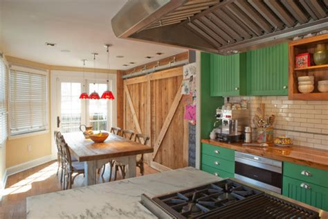From rustic to chic: 15 kitchens with barn door accents
