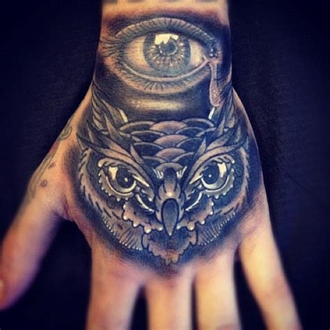 owl hand tattoo owl tattoos are massively popular with both and