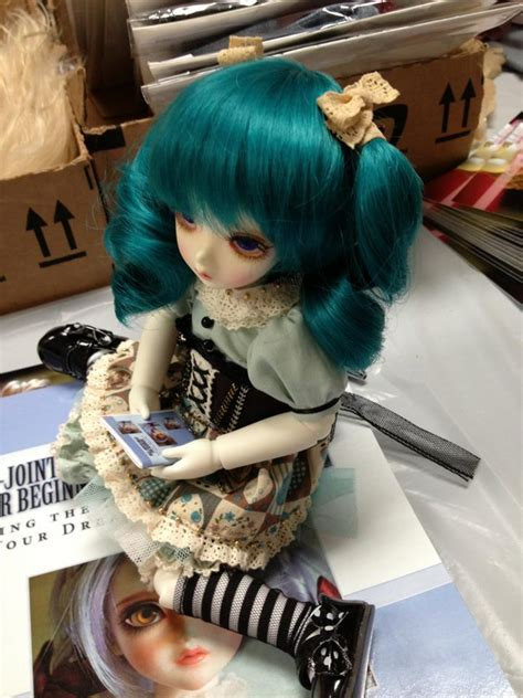 jointed dolls for beginners peak s woods holding a miniature copy of my