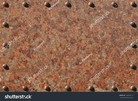heavily rusted metal plate rusted riveted stock photo