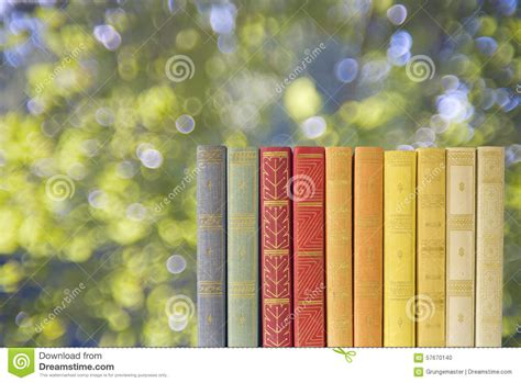 nature s gift books row of books w nature background stock photo image