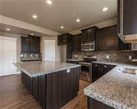 kitchen cabinets maple espresso countertops formica 1000 ideas about caledonia granite on pinterest granite