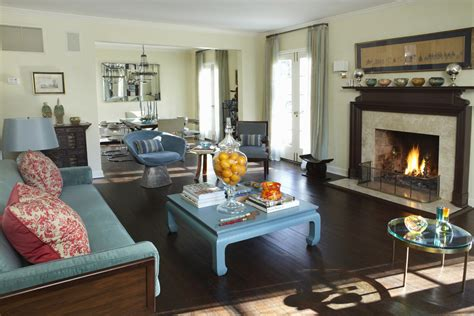 living room decore ideas dark wood flooring plus sofa and turquoise coffee table