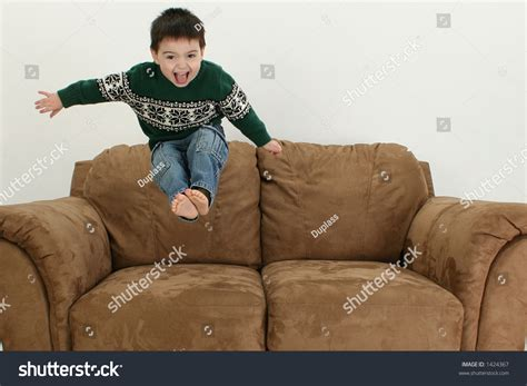 boy on couch small boy jumping on couch stock photo 1424367 shutterstock