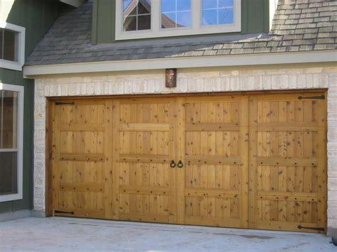 French Country Garage In Cedar Park Beige Stone Siding Country Overhead Door