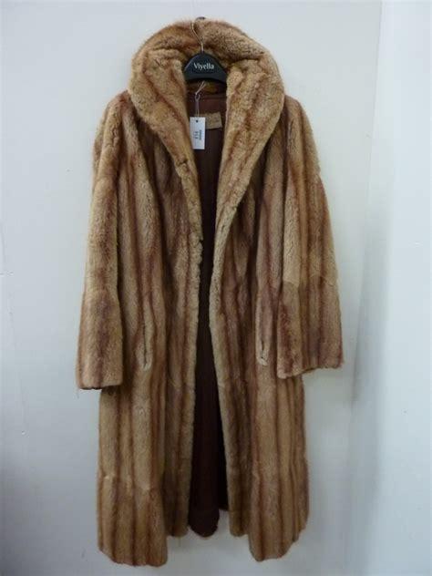 vintage clothing musquash fur coat bearing label