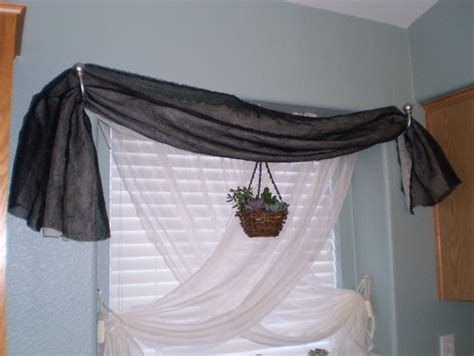 how to hang scarves on curtain rods how to keep window scarves from sagging in sconces