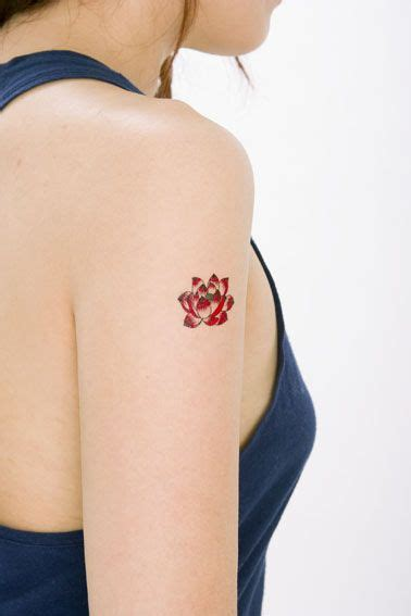 red lotus tattoo and body piercing red lotus tattoo arm beautifully tattooed pinterest