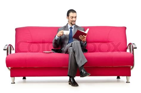 sitting on the sofa man sitting on the sofa stock photo colourbox