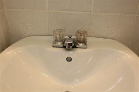 how to get rust off bathroom fixtures more unexpected plumbing two flat remade