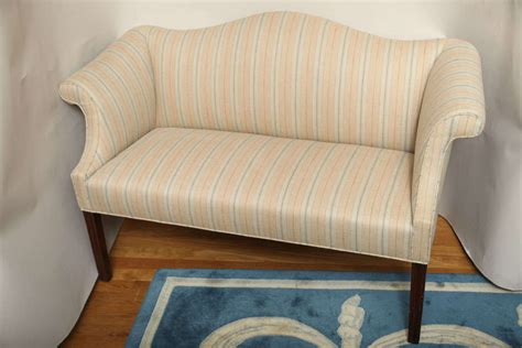 a small scale chippendale style camelback sofa at