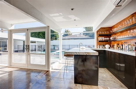 two story mid century home gets fancy remodel