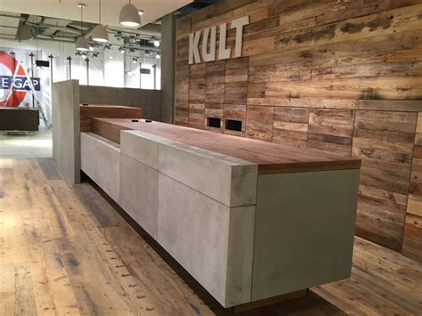 Business Countertops - cement sale counter in fashion store reception desks