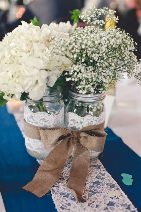 Tie together mason jars with a ribbon to create a center
