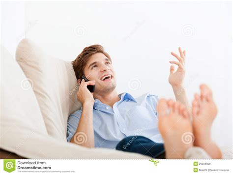 lying on sofa royalty free stock images image