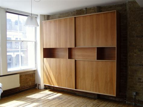 Sliding Plywood Doors by Bookcase With Sliding Doors Stonermakes