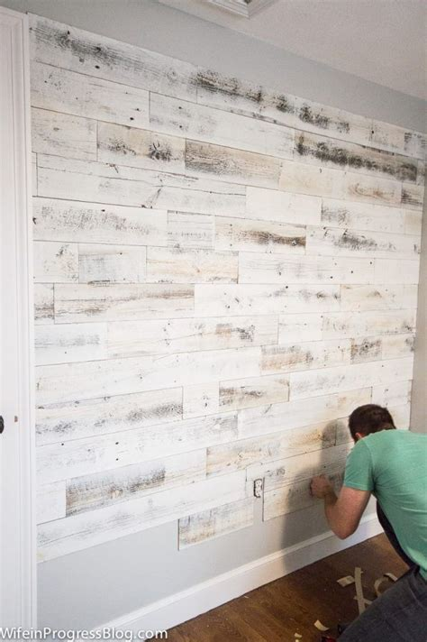best way to stick pictures on wall reclaimed wood wall the easiest way to create a stunning