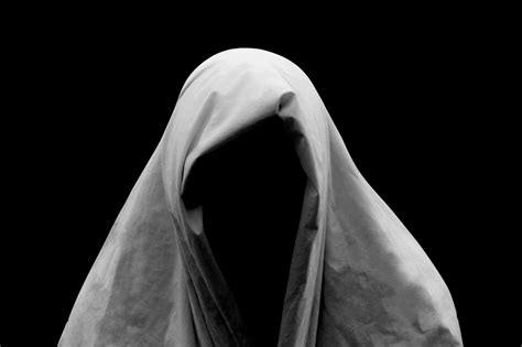 black ghost spooky ghost on a black background stock image