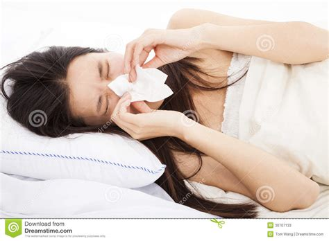 with flu and laying in bed stock photos image
