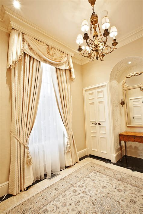 formal window coverings hung   crown molding