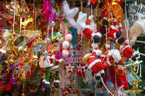 various christmas tree decorations on the street market in