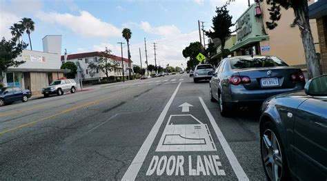 in a wide lane ride 3 or 4 feet to the right of cars 5 santa monica door lane bike lane gary kavanagh flickr
