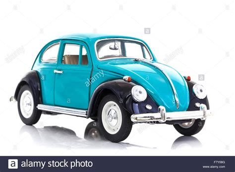 old blue volkswagen old blue die cast vw beetle model on a white background