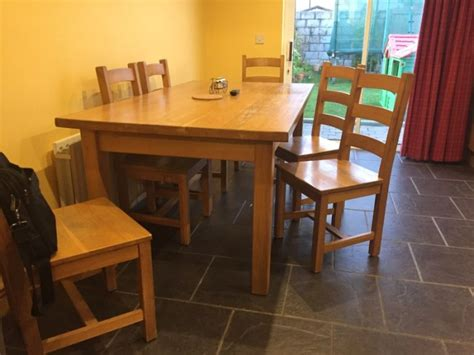 solid oak large kitchen table and 6 chairs for sale in